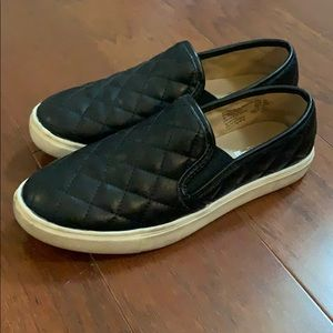 Black quilted slip ons
